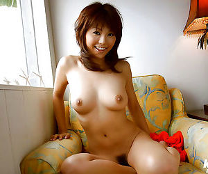 Sexy asian babe with big tits Azumi Harusaki stripping off her clothes