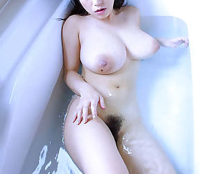 Sexy asian babe with massive bosoms stripping and taking bath