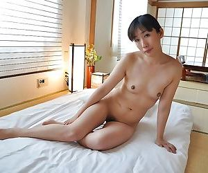 Rammish asian gal with tiny tits Rumi Hirose has some pussy toying fun