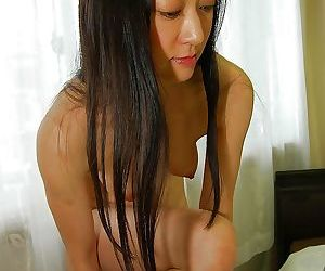 Shy asian lady with hairy cooter slowly uncovering her fuckable curves