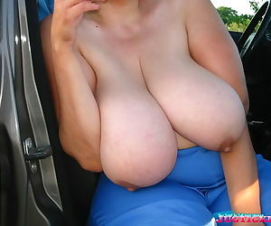 Mature plumper showing her big boobs in the car outdoors - part 3355