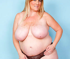 Big babe plays with her massive natural juggs - part 3095