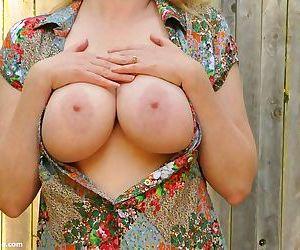 MILF Tasty Trixie reveals her big juicy juggs and masturbates at the backyard