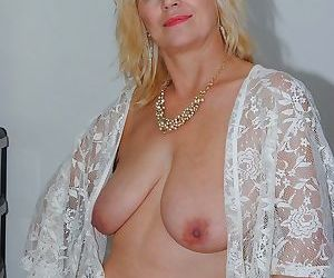 Dirty British mature slut Dimonty showing her big saggy tits and she loving it