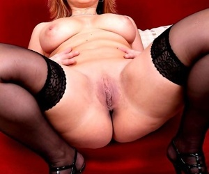 Pudgy mature wife sits her fat pussy down on a big black cock