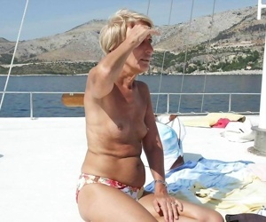 Real amateur grannies showing off their goodies - part 1831
