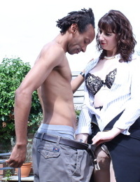 Cheating UK housewife seduces a black man in a black skirt on patio