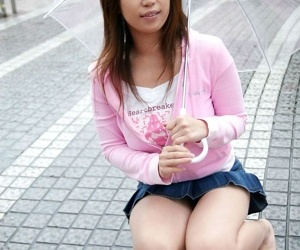 Young Japanese girl Yuka exposes her great tits in solo action