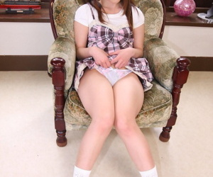 Japanese girl Arisa Suzuki lifts her dress to expose her underwear in socks