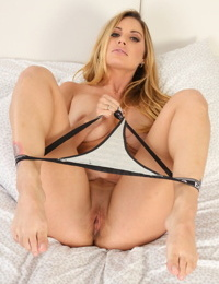 Tattooed girl Teagan Presley removes bra and panties before parting labia lips