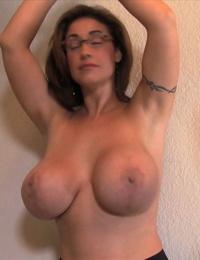 Big boobed female Eva Notty endures tickle torture in glasses