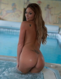 British model Natalia Forrest rolls off stockings to model totally naked