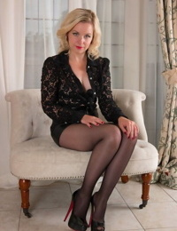 Elegant blonde Anna Belle strips and rips a crotch hole in her black pantyhose