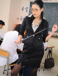 Japanese schoolteacher Yui Komine monitors students with pointer in hand