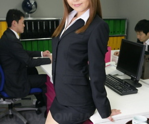 Japanese office worker Saki flashes white underwear at her desk