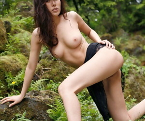 Beautiful Japanese girl Yua Aida exposes her firm tits amid natures beauty