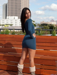 Very sexy Latina in tight dress and boots shows her smooth pussy in public