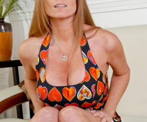 Tall mature lady Darla Crane flashes her up skirt panties in red heels