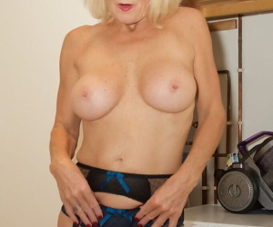 Mature blond Molly MILF strips naked after doing housework in 3 piece lingerie