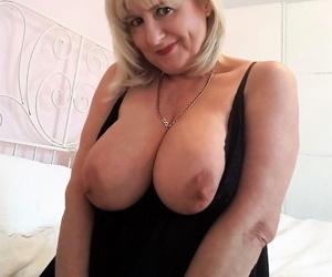 Thick older woman Lornablu slides sheer panties aside to display her bald twat