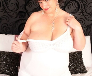 Mature BBW fans herself while modeling non nude in vintage underwear and hose