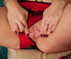 Older woman Louise Pearce finger spreads her moist pussy in her debut