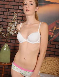 Petite amateur Tiffany Monroe removing blouse and shorts for nude poses