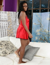 Nerdy black girl Janelle Taylor shows off her hairy pits and bush on a sofa