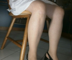 Older lady with great legs reveals her sweaty hair covered armpits
