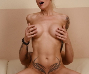Mature blonde Sophie Logan copulates with young partner on sofa