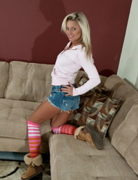 Amateur chick Kendra Rain shows off her big tits in striped knee socks