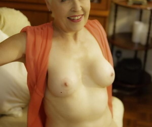Mature Lady Sextasy undressing to reveal firm breasts & spread in stockings