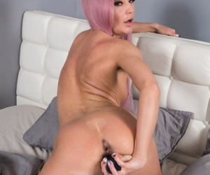 Mature Lola in silly pink pigtails flashes hairy beaver & toys with dildo
