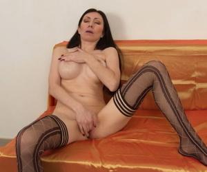 Mature MILF masturbates during solo action in sexy stockings