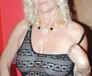 Older blonde cups her big breasts while letting a nipple slip thru