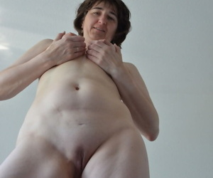 Totally naked amateur shows off her unshaven armpits and shaved pussy