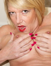 Older blonde woman Dirtydoctor fingers herself after uncupping big boobs