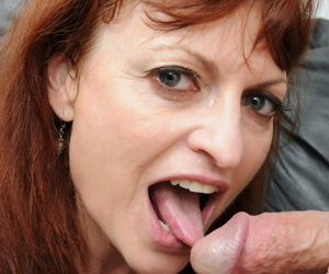 Mature redhead Kelly Nichols sucks a cock before riding on top in tan nylons