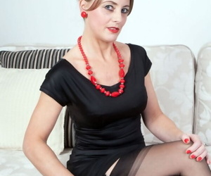 Office lady Tricia West strips to her exotic lingerie and exposes mature holes
