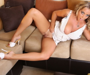 Hot mature blonde Amber Lynn Bach gets on her knees to show naked pussy
