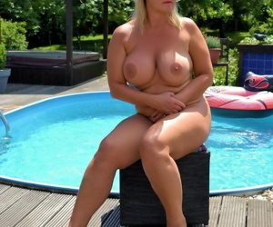 Sexy mature Chrissy models firm big tits & chubby nude body on and by the pool