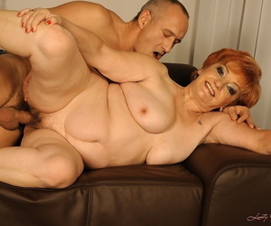 Redhead mature woman Justina opens her hairy cunt for stiff dick