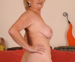 Saucy granny Effie flaunts her nice tits & hairy twat before fucking stud boy