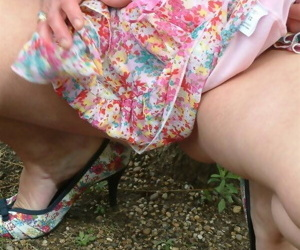 Older UK woman hikes her dress to finger fuck in a public place
