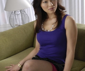Hot Japanese Rio Saski in fishnets flashes nice medium tits & sexy panties