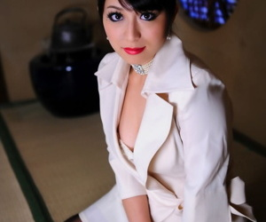 Japanese model exposes her high end brassiere in a business suit and red lips