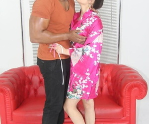 Japanese beauty Miyuki Son puts her robe back on a after sex with a black man