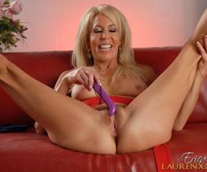 Mature blonde bombshell Erica Lauren in red dress masturbating pussy close up
