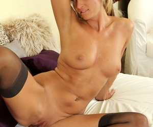 Hot blonde Shyla peels black lingerie to spread pussy in stockings for closeup