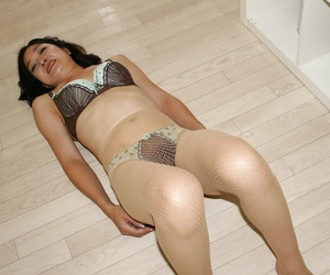Asian lady in lingerie and pantyhose Chiyo Yamabe revealing her perky tits